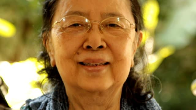 Asian old woman feeling happy
