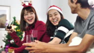 Asian People Celebrating in Christmas Event at home