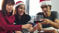 Asian People clinking glasses and Celebrating in Christmas Event at home