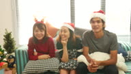 asian people enjoying Christmas party at home