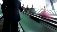 Asian people on pedestrian escalator, time lapse.