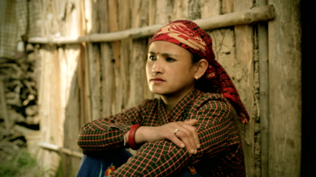 Asian people: Portrait of mature Nepalese women with blank expression.