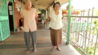 Asian senior couple exercise arm in the house