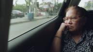 Asian senior woman on road trip in car