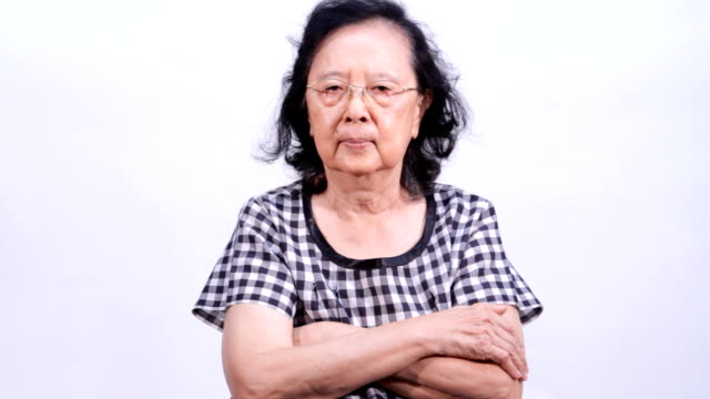 Asian senior woman showing disallowable sign