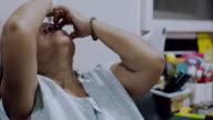 Asian Senior Woman Use Eyedropper To Her Eye