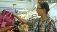 Asian senior women shopping in shopping mall