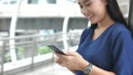 Asian Teens Using Social Media outdoor, Smiling