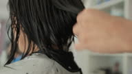 Asian woman haircut in beauty salon
