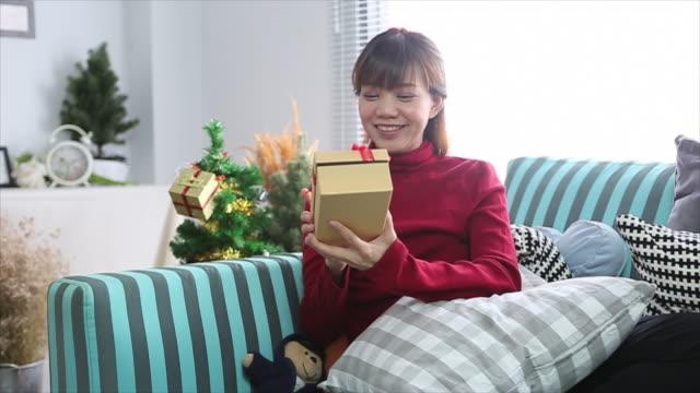 asian woman open christmas box