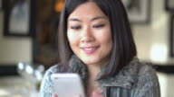 Asian woman, phone message.