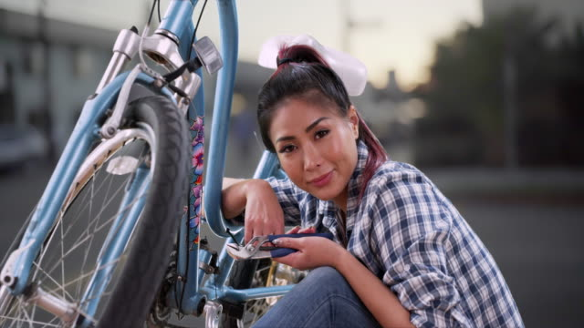 Asian woman smiling with her bike