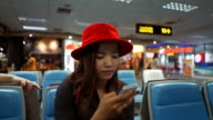 Asian woman use smart phone in airport