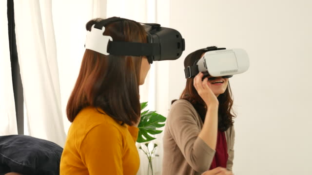 Asian woman use virtual reality glasses ( VR )