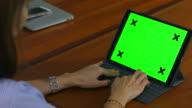 asian woman using computer green screen
