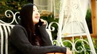 Asian woman using mobile phone,communicate friend