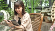 Asian woman using Tablet PC