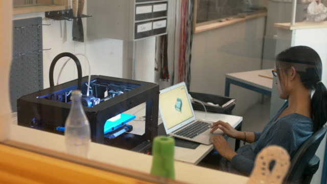 Asian woman working with 3D Printer
