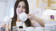 Asian women Barista smiling and holding coffee cup and using machine in coffee shop counter - Working woman small business owner food and drink cafe concept