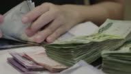 Asian Women Counting Money Thai Baht On Her Workplace In Home