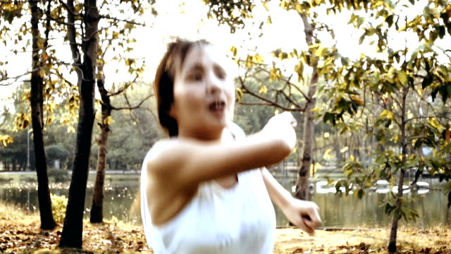 Asian Women Exercising In The Public Park At Sunset