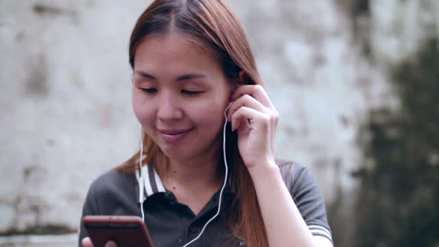 Asian Women Listens To Podcast
