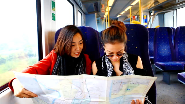 HD:2 Asian women looking the map.