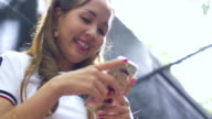 Asian Women Using Mobile Phone