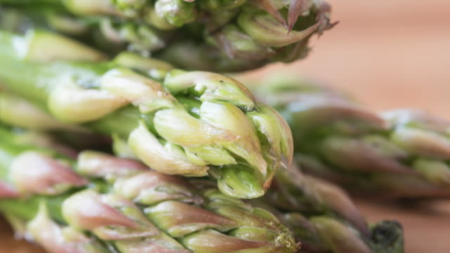 Asparagus shoots close up. The vegetable is prepared and served in a number of ways around the world, typically as an appetizer or vegetable side dish