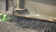 CU Asphalt laying machine working on resurfacing of road / Saarburg, Rhineland-Palatinate, Germany