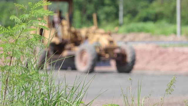 Asphalt Road Construction and Street road work place with bulldozer prepare gravel
