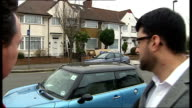 West London Malik AlAbdeh standing with reporter outside Asma alAssad's parents' home