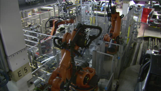WS Assembly line robots in motion at BMW car plant / Munich, Bavaria, Germany
