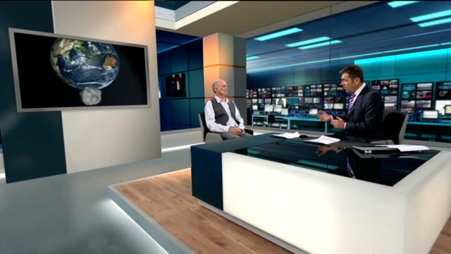 London GIR INT Nigel Henbest LIVE STUDIO interview SOT saying asteroid not connected to meteor that crashed in Russia very close on cosmic scale