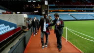 Midlands Birmingham Villa Park INT Aston Villa shirt with Bent's name on back Bent and others out of tunnel and into stadium as man gives Bent Villa...
