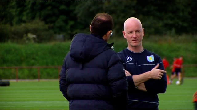 Aston Villa training More of Aston Villa players training on pitch playing football being watched by O'Neill including Maloney ReoCoker