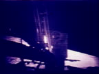 Astronaut Buzz Aldrin stepping off lunar lander onto Moon / Neil Armstrong in BG / Aldrin saying 'beautiful viewmagnificent site out here' / they...