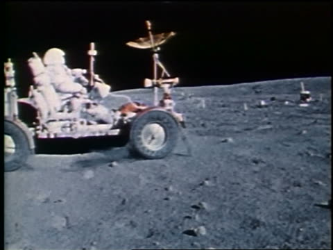 PAN astronaut driving lunar rover on Moon surface / Apollo 16