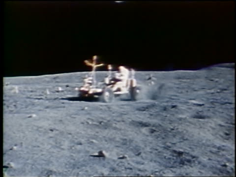 PAN astronaut driving lunar rover on surface of Moon / Apollo 16