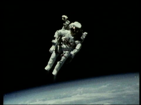 Astronaut floating in space above earth on space walk