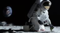 MS SLO MO Astronaut gardening on the moon / Berlin, Germany