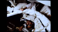 / Astronaut Harrison Schmitt inside Command Module wearing sunglasses and floating upside down Astronaut Harrison Schmitt on Apollo 17 mission on...