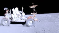 Astronaut John Young driving Lunar Rover Vehicle on moon surface during Apollo 16 mission / rover kicks up dust as it drives around in circles