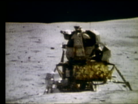 Astronaut John Young running past lunar module on moon during Apollo 16 space mission on April 21 1972