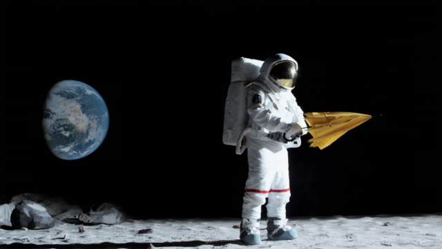 http://media.gettyimages.com/videos/astronaut-on-moon-opening-his-umbrella-berlin-germany-video-id103250347?s=640x640