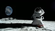 WS SLO MO Astronaut on moon unplugging cord from extension cord / Berlin, Germany