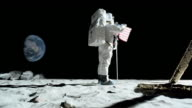 WS SLO MO Astronaut putting up American flag on the moon and saluting / Berlin, Germany