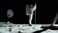 WS SLO MO Astronaut putting up German flag on moon and saluting / Berlin, Germany