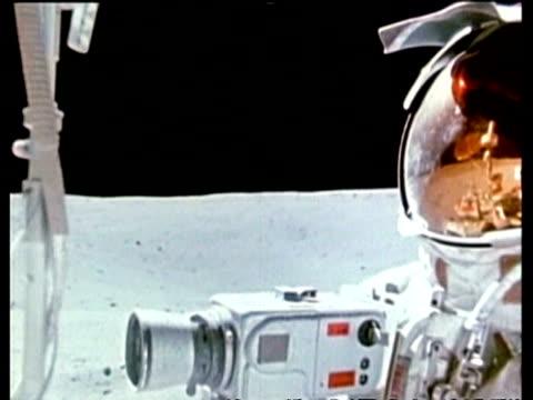 CU astronaut riding on Moon Rover