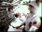 1969 MONTAGE Astronaut shaving in spacecraft